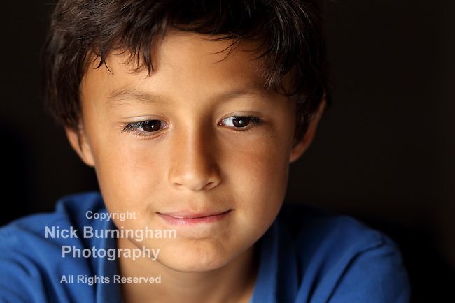 Portrait of young school boy with chiaroscuro lighting - shallow depth of field