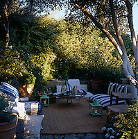 An al fresco comfortable seating area hidden in the garden of a Mediterranean villa