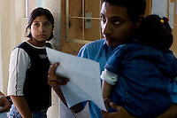 Wilma Janet Chacon (left), 17, learns at a children's court that she will not be given custody of her daughter until she proves that she will stay off the street and off drugs. Geovanni Marroquín, the child's father at right, is a reformed former street youth now back at home and in school. The mediator told Chacon she has two months to straighten up. A week later, she was back on the streets.