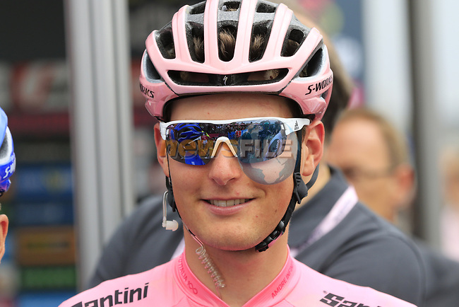 Race leader Maglia Rosa wearer Lukas Postlberger (AUT) Bora-Hansgrohe arrives at sign on before Stage 2 of the 100th edition of the Giro d'Italia 2017, running 221km from Olbia to Tortoli, Sardinia, Italy. 6th May 2017.<br /> Picture: Ann Clarke | Cyclefile<br /> <br /> <br /> All photos usage must carry mandatory copyright credit (&copy; Cyclefile | Ann Clarke)