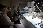 """Visitors look at a model of the Japanese experimental space module """"Kibo"""" on display at the city science museum in Nagoya, Aichi Prefecture, Japan on 13 Oct. 2011. Photograph: Robert Gilhooly"""