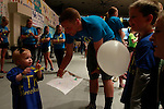 Ashtynn, 2, bounces a balloon with Tyler, 7, at DanceBlue on March 3, 2012 in Memorial Coliseum.
