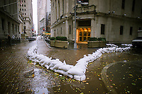 "Sandbags are used to protect the entrance to the closed New York Stock Exchange in New York on Monday, October 29, 2012. Hurricane Sandy continues its steady advance with heavy wind and rain. New York has shut down the schools, the transit system and the Holland and Hugh L. Carey Tunnels have been closed. Evacuations have been ordered in the ""Zone A"" areas including Battery park City. (© Richard B. Levine)"