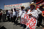 Mexican peasants demand to freed political prisoners during the May Day rally at the Mexico City's main square Zocalo, May 01, 2010. Thousands of workers marched on a Mexico City main thoroughfare demanding president Felipe Calderon to quit office. Photo by Heriberto Rodriguez