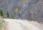 sharp turn road sign up rock creek drainage in montana