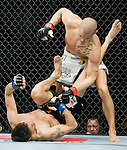 Dustin Poirer, top, pounds on Pablo Garza at Saturday's UFC on Fox event at the Honda Center.