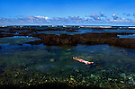Winn Gossler floats along through the tide pools at Kapoho on the Big Island, Hawaii.