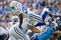 NASHVILLE, TN - OCTOBER 30:   Joe Lefeged #35 of the Indianapolis Colts dives over the pile during a game against the Tennessee Titans at the LP Field on October 30, 2011 in Nashville, Tennessee.  The Titans defeated the Colts 27 to 10.  (Photo by Wesley Hitt/Getty Images) *** Local Caption *** Joe Lefeged