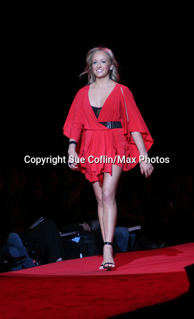 Olympian Nastia Liukin wearing Max Azria walks the runway at The Heart Truth's Red Dress Collection 2009 Fashion Show which raises awareness that heart disease is the #1 killer of women was held during Mercedes -Benz Fashion Week New York Fall 09 on February 13, 2009 in Bryant Park, New York City, NY. This event unites with America's top designers to showcase a colleciton of one-of-a-kind Red Dresses. (Photo by Sue Coflin/Max Photos)
