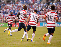 Eddie Johnson (26) of the United States celebrates his goal during the quarterfinals of the CONCACAF Gold Cup at M&T Bank Stadium in Baltimore, MD.  The United States defeated El Salvador, 5-1.