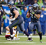 Seattle Running back Marshawn Lynch scampers for a 20-yard touchdown against the against the Washington Redskins in the second quarter at  CenturyLink Field in Seattle, Washington on November 27, 2011. Lynch ran for 111 yards on 24 carries and scored one touchdown inSeattle Seahawks 17-23 loss to the Redskins. ©2011 Jim Bryant Photo. All Rights Reserved.