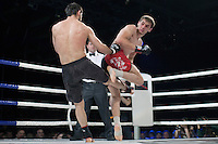 Moscow, Russia, 05/06/2010..Marat Peksov kicks Rasul Mirzaev in a mix-fight bout during the new Fight Nights boxing tournament, featuring kick-boxing, boxing and mixed fighting.