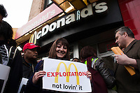 A woman holds a banner in front of a McDonald's restaurant while she takes part in a  protest for Increased their wages in New York, April 04, 2013. Photo by Eduardo Munoz Alvarez / VIEWpress.
