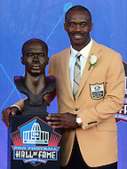 Canton, OH - August 6, 2016: Former NFL player Marvin Harrison poses with his bust after giving his speech at the Pro Football Hall of Fame Enshrinement Ceremony in Canton, Ohio, August 6, 2016. Harrison retires after the 2008 season with 1,102 career receptions, 128 touchdown and 14,580 yards, which ranked him 4th all-time.  (Photo by Don Baxter/Media Images International)