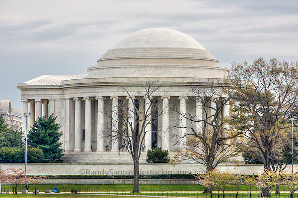 Jefferson Memorial Washington DC<br /> The Jefferson Memorial is a presidential memorial, located on the Tidal Basin in Washington, D.C.. Dedicated to American Founding Father Thomas Jefferson -  architecture includes circular marble steps, a portico, a circular colonnade of Ionic order columns, and a shallow dome. The interior includes a statue of Thomas Jefferson and excerpts from the Declaration of Independence. A popular Washington DC tourist attraction, especially in Spring during the blooming of the Cherry Blossoms.