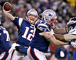 New England quarterback Tom Brady passes the ball as tackle Nick Kaczur provides protection against the Eagles' defense at Gillette Stadium in Foxborough on Sunday, Nov. 25, 2007.