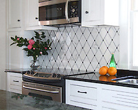 Quilt backsplash shown in Calacatta Tia, Nero Marquina, and Bardiglio.