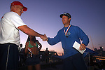 Tournament organizer Dave Healy (left) shakes hands with his rowing partner Warren Towns during the awards ceremony after the First Annual Asbury Park Beach Bar Lifeguard Competition held at the 3rd Avenue beach in Asbury Park. ASBURY PARK, NJ  8/4/07  8:21:47 PM  PHOTO BY ANDREW MILLS