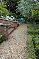 A long gravel path runs along the length of the sunken garden