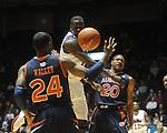 Ole Miss'  Eniel Polynice (14) vs. Auburn's Frankie Sullivan (20) and Tay Waller (24) in Oxford, Miss. on Wednesday, February 24, 2010. Ole Miss won 85-75, giving coach Andy Kennedy his 100th win as a head coach.