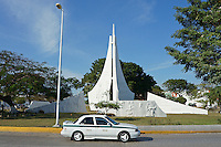 Taxi in a traffic roundabout or glorieta on Avenida Tulum in downtown, Cancun, Quintana Roo, Mexico.