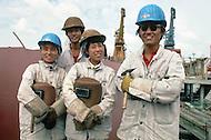 October 1984. Shaghai Shipyard. Workers building ship.