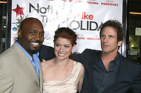 "James Black, Debra Messing & Hart Bochner  arriving at the Premiere of ""Nothing Like the Holidays"" at the Grauman's Chinese Theater in Hollywood, CA.December 3, 2008.©2008 Kathy Hutchins / Hutchins Photo....                ."