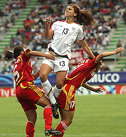 Chile, Temuco: Usa forward Alex Morgan (C) goes for the ball along with (C) Weng Xinzhi (L) the Chine team, during the final match on the group, Fifa U-20 Womens World Cup the at German Becker stadium in Temuco , on November 26 2008. Photo by Grosnia/ISIphotos.com