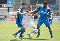Sean Franklin (28) asks for a call against Joey Gjertsen (left) and Khari Stephenson (right). The San Jose Earthquakes defeated the LA Galaxy 1-0 at Buck Shaw Stadium in Santa Clara, California on August 21st, 2010.