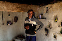 Bishnoi man in his house. Bishnoi men are generally identified by their white traditional dress of kurta and dhoti but now new genaration people donot wear that it can be only seen among the older people of this sect. Jodhpur, Rajasthan, India. Arindam Mukherjee