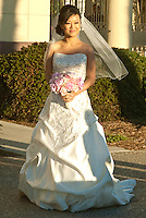 Bride Louise Tao makes her way to the altar during her wedding ceremony at Santa Monica Beach on Sunday, November 11, 2012.