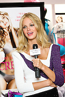 Erin Heatherton being interviewed during the &quot;Incredible by Victoria's Secret&quot; launch at the Victoria Secret SOHO Store, August 10, 2010.