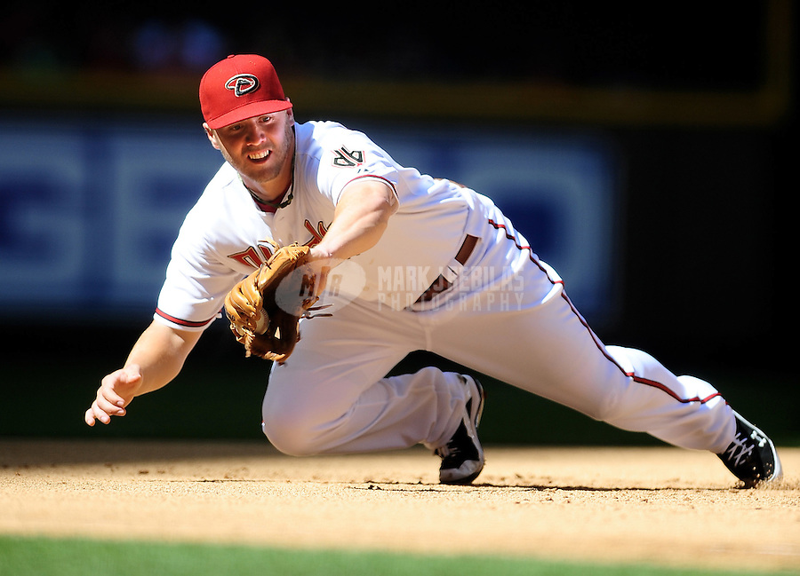 Apr. 5, 2010; Phoenix, AZ, USA; Arizona Diamondbacks third baseman Mark Reynolds makes a diving catch for an out in the second inning against the San Diego Padres during opening day at Chase Field. Mandatory Credit: Mark J. Rebilas-