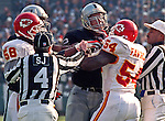 Oakland Raiders vs. Kansas City Chiefs at Oakland Alameda County Coliseum Saturday, December 26, 1998.  Chiefs beat Raiders  31-24.  Kansas City Chiefs linebacker Greg Favors (54) and Oakland Raiders tackle Lincoln Kennedy (72) have a discussion.