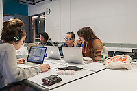 Participants collaborate on developing computer games at a game jam at NYU-Poly in downtown Brooklyn in New York on Sunday, September 29, 2013. With women making up only 4 percent of game developers the Code Liberation project at NYU-Poly invited women coders of different skill levels to participate in a weekend long game jam to encourage more women to enter the tech fields. Over 20 women participated, working in teams to develop their games.  (© Richard B. Levine)