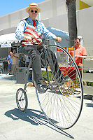 Dennis Forel rides a Penny Farthing during Santa Monica Public Library's bicycles and cycling iCycle festival on Saturday, May 22, 2010.