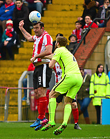 Lincoln City's Matt Rhead vies for possession with York City's Shaun Rooney<br /> <br /> Photographer Andrew Vaughan/CameraSport<br /> <br /> Buildbase FA Trophy Semi Final Second Leg - Lincoln City v York City - Saturday 18th March 2017 - Sincil Bank - Lincoln<br />  <br /> World Copyright &copy; 2017 CameraSport. All rights reserved. 43 Linden Ave. Countesthorpe. Leicester. England. LE8 5PG - Tel: +44 (0) 116 277 4147 - admin@camerasport.com - www.camerasport.com