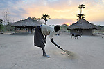 Rosa Lonyako, 10, sweeps around her family's home early in the morning in Pisak, a small village in Central Equatoria State in Southern Sudan. NOTE: In July 2011, Southern Sudan became the independent country of South Sudan