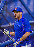 4 April 2015: Toronto Blue Jays infielder Devon Travis awaits his turn in the batting cage prior to an exhibition game against the Cincinnati Reds at Olympic Stadium in Montreal, Quebec, Canada. The Blue Jays defeated the Reds 9-1 in the second of two MLB weekend exhibition games. Mandatory Credit: Ed Wolfstein Photo *** RAW (NEF) Image File Available ***