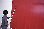 Painting a wall red, in Kunming, one of the cities visited by the Think Uk Writers Train. The Think UK China Writers Train is a project, in collaboration with the British Council, to take 4 UK writers/poets and 4 Chinese writers/poets around China by train visiting 6 major cities to hold talks, seminars and readings of their work.