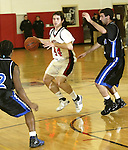 SOUTHBURY, CT, 01/02/08- 010208BZ09- Pomperaug's Andrew Conlan (44) under pressure from Bunnell's Chris Rosario (12), left, and Jon Dinihanian (22) during their game at Pomperaug High School in Southbury Wednesday night.<br /> Jamison C. Bazinet Republican-American