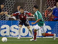 Mexico goalkeeper Oswaldo Sanchez yells instructions to his defender Carlos Salcido. USA 2, Mexico 0, at the University of Phoenix Stadium in Glendale, AZ on February 7, 2007.