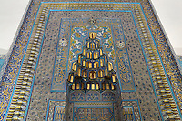 Mihrab of the Green Tomb or Yesil Turbe, mausoleum of the 5th Ottoman Sultan Mehmed I Celebi, Bursa, Turkey. The ornate mosaic of Iznik tiles inside the niche depicts a garden of roses, carnations and hyacinths. The tomb was built by Mehmed's son and successor Murad II following Mehmed's death in 1421 and is so named because of the green-blue tiles which cover the exterior. The architect, Haci Ivaz Pasha, designed the tomb and the Yesil Mosque opposite. Picture by Manuel Cohen