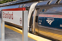 A northbound Amtrak Northeast Regional train picks up speed as it departs from Stamford Station in Stamford, Connecticut.