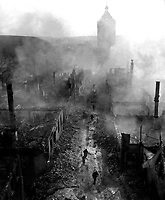Infantrymen of the 255th Inf. Regt. move down a street in Waldenburg to hunt out the Hun after a recent raid by 63rd Division.  April 16, 1945.  2d Lt. Jacob Harris. (Army)<br /> NARA FILE #:  111-SC-205778<br /> WAR &amp; CONFLICT BOOK #:  1095