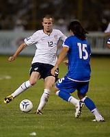 Michael Bradley (12) dribbles the ball against Alfredo Pachecho (15) during FIFA World Cup qualifier against El Salvador. USA tied El Salvador 2-2 at Estadio Cuscatlán Stadium in El Salvador on March 28, 2009.