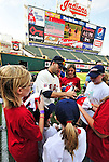 """6 September 2009: Cleveland Indians' utilityman Jamey Carroll signs autographs for kids in the """"Kick-It"""" program designed to unite communities in the fight against pediatric cancer. Carroll played kickball with the kids on the field after a game against the Minnesota Twins at Progressive Field in Cleveland, Ohio. The Indians defeated the Twins 3-1 to take the rubber match of their three-game weekend series. Mandatory Credit: Ed Wolfstein Photo"""