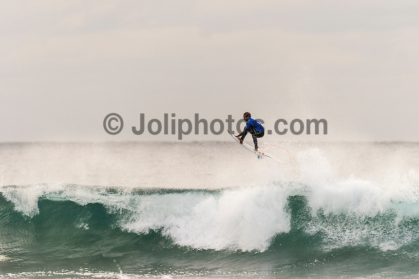 Bells Beach, Torquay, Victoria, Australia (Friday, March 25 2016): Caio Ibelli (BRA) -<br /> Round One of the Men's Rip Curl Pro hit the water at 8 am this morning and there were 6 heats run before the tide filled in and the event was called off for the day.<br /> There were light South West to North West winds through the morning with the swell in the 3'-4' range.<br /> <br /> Bells Beach has been hosting surfing tournaments for more than 50 years now, making it the most renowned spot on the raw and rugged southern coast of Victoria, Australia. The list of  Rip Curl Pro event champions is a veritable who's who of surfing icons, including many world champions.<br /> <br /> Surfing's greats have a way of dominating Bells. Mark Richards, Kelly Slater, and Mick Fanning all have four Bells trophies; Michael Peterson and Sunny Garcia, three; While Simon Anderson, Tom Curren, Joel Parkinson, Andy Irons, and Damien Hardman each grabbed a pair.<br /> <br /> The story is similar on the women's side. Lisa Andersen and Stephanie Gilmore have four Bells titles; Layne Beachley and Pauline Menczer, three; while Kim Mearig and Sally Fitzgibbons each have two.<br /> <br /> The 2016 event is about to kick off tomorrow and there was a packed warm up session at Bells this morning. <br /> Photo: joliphotos.com