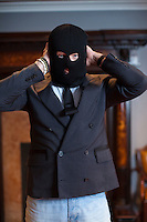 Moscow, Russia, 11/11/2010..Russian businessman and former KGB officer Alexander Lebedev in one of his central Moscow offices wearing a black balaclava mask of the kind often worn by Russian security forces. Last week Lebedev's National Reserve Bank headquarters were raided and searched by armed Russian security forces wearing such masks. Among Lebedev's business properties are the National Reserve Bank, the Russian newspaper Novaya Gazeta and four UK Newspapers: the Evening Standard, The Independent, the Independent on Sunday and the new i newspaper.