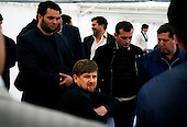 """Chechen President Ramzan Kadyrov attends a horse race in Moscow's Hippodrome..Kadyrov's horse, """"Royal Quiet"""", came first in the 1600-metre race. .The horse, born in the U.S.A., is parented by father: Real Quiet, mother: Dinasoar, is trained by S. G. Kolesnikov and rode by master jockey S. V. Petin."""